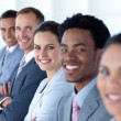 Stock Photo: Beautiful businesswomwith her team in line