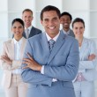 Smiling businessman leading his team - Stock Photo