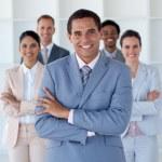 Smiling businessman leading his team — Stock Photo