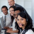 Portrait of a businesswoman in a call center with her team — Stock Photo