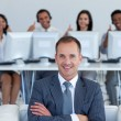 Manager in call center with his team with thumbs up — Stock Photo