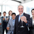 Stock Photo: Happy diverse business group toasting with Champagne