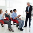 Business applauding at the end of a conference — Stock Photo