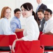 Attractive caucasian businesswoman at a conference — Stock Photo