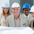 Architects with hardhats in a building site — Stock Photo