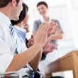Jolly business applauding good presentation — Stock Photo #10825130