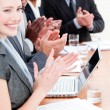 Cheerful business applauding a good presentation — Stock Photo #10825145