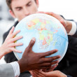 Royalty-Free Stock Photo: Close-up of a business team holding a terrestrial globe