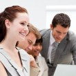 Portrait of smiling businesswomworking with her colleagues — Stock Photo #10825196