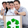 Stock Photo: Young business showing the concept of recycling