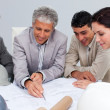 Constructors in a meeting studying plans — Foto Stock