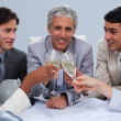 Happy engineer team celebrating a success with champagne — Stock Photo