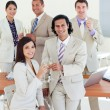 Stock Photo: Happy business team celebrating a success