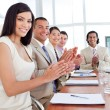 Multi-ethnic business team applauding after a conference — Stock Photo #10825271