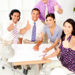 Stock Photo: A group of architects with thumbs up in a meeting