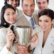 A successful business team holding a trophy — Stock Photo