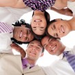 Smiling business team in a circle with heads together — Stock Photo