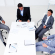 Stock Photo: High angle of a smiling business team in a meeting