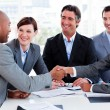 Multi-ethnic business greeting each other - 