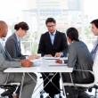 Stock Photo: Diverse business group disscussing budget plan