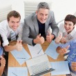 High angle of a cheerful business team with thumbs up — Stock Photo