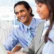 Laughing businessmworking with his team — Stockfoto #10825390