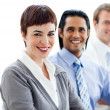 Multi-ethnic co-workers smiling at the camera — Stock Photo