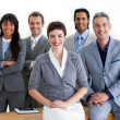 Confident multi-ethnic business around a conference table — Stock Photo #10825404