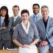 Confident multi-ethnic business around a conference table — Stock Photo