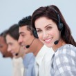 Attractive business woman and her team working in a call center — Stock Photo #10825436