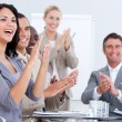 Cheerful business applauding in meeting — Stock Photo #10825534