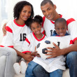 Smiling family holding a soccer ball — Stock Photo #10825561
