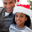 Stock Photo: Portrait of an Afro-American father and son holding a Christmas