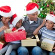Happy Afro-American family playing with Christmas presents — Stock Photo