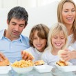 Stock Photo: Loving family eating hamburgers