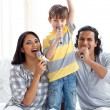 Stock Photo: Animated family singing with microphones
