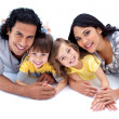 Lively family lying on the floor — Stock Photo