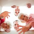 Stock Photo: Joyful family unpacking boxes
