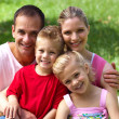 Stockfoto: Close-up of a happy family smiling at the camera