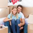Intimate couple embracing after move in — Stock Photo #10825768