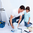 Royalty-Free Stock Photo: Attentive father and his son decorating their house