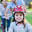 Smiling little girl riding a bike — Stock Photo
