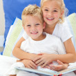 Blond brother and daughter reading books — Stock Photo