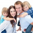 Portrait of family enjoying piggyback ride — Stock Photo #10825868