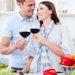 Stock Photo: Affectionate couple drinking wine while cooking