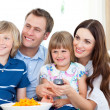 Smiling family watching TV — Stock Photo #10825881