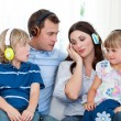 Family listening music with headphones — Stock Photo #10825884