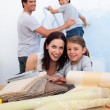 Smiling family doing up their new home — Stock Photo