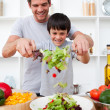 Little boy and his father cooking — Stock Photo #10825903