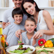 Stock Photo: Smiling family cooking together